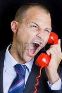 8362593-man-shouting-into-a-red-telephone
